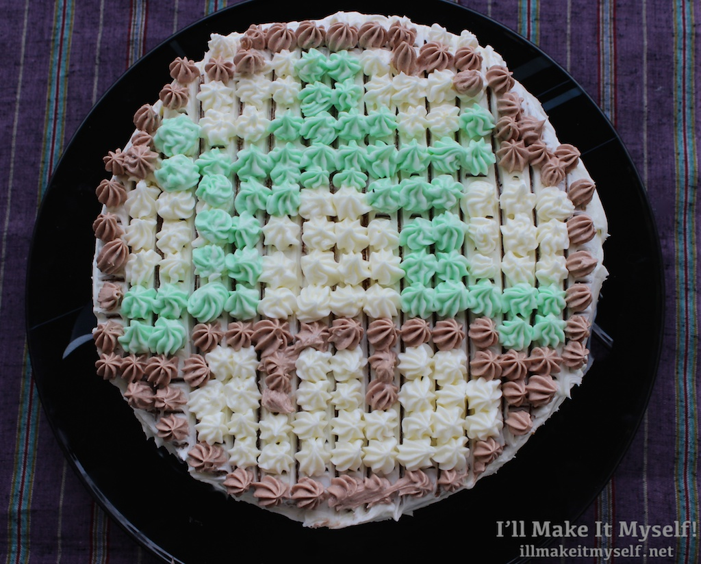 Image of pixelated 1-up Mario mushroom cake