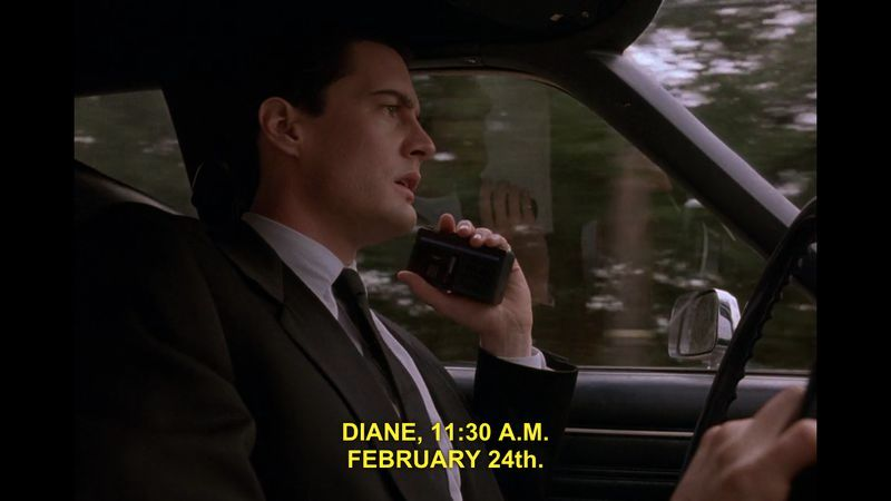 "Image: Kyle Maclachlan as Special Agent Dale Cooper in Twin Peaks. He is driving and speaking into a tape recorder. ""Diane, 11:30 AM. February 24th."""